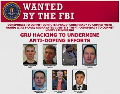 Минюст США показал фотографии россиян, обвиняемых в хакерских атаках