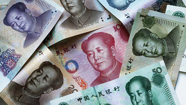 Центробанк Китая опустил курс юаня к доллару до минимума с 2008 года