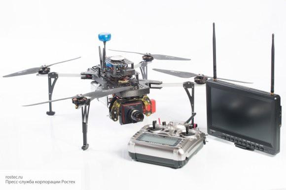 Китайские ученые заставили работать в паре робота и дрон